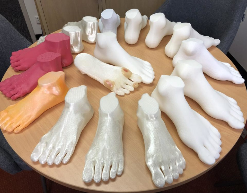 These are 3D-printed feet, some enhanced with foot ulcers